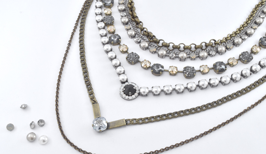 Layers of necklaces with crystals and pearls