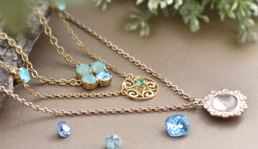 Necklaces made with gold pendants & SW crystals