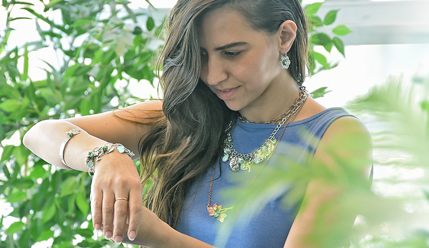 Green nature themed jewelry with plenty of charms